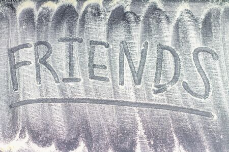Caption Friends of flour on a gray background. Stock Photo