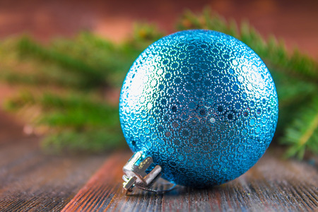 toy balls on the background of Christmas tree branches on a wooden background. Stock Photo