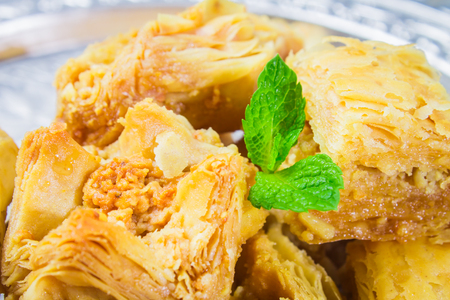 baklava: Jewish, turkish, arabic traditional national dessert. Macro. Selective focus. Baklava with honey and nuts
