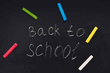 erased: Back to school message on Blackboard inscribed with colorful chalk for background
