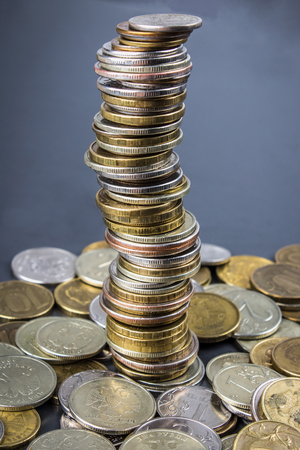 uk money: Stacks of Russian coins on a gray background with droplets of water