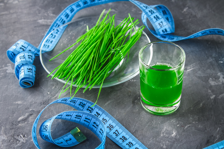 Wheatgrass shot. Juice from wheat grass. Trend of health