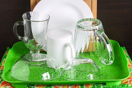 Pure dishes are dried. A glass, a mug, a board, a plate, cutlery
