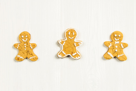 Gingerbread men friends on a white wooden table