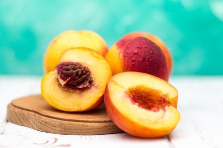 a lot of fresh peaches on a white table Фото со стока - 92392483