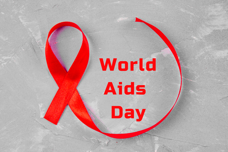 Red ribbon awareness for World aids day concept