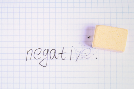 Eraser erasing on the sheet in the cage word: negative