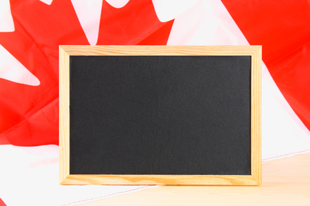 Blackboard with the national flag of Canada drawn on and a chalk Stock Photo