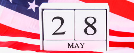 USA Memorial Day concept with calendar and red remembrance poppy on American stars and stripes flag Stok Fotoğraf
