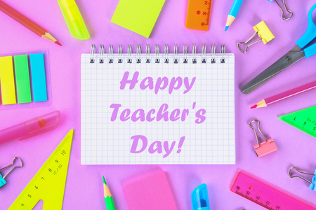 Happy Teachers Day. School supplies on violet background ready for your design. Flat lay. Top view.
