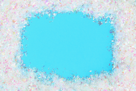 Frame out of the snow, blue background. New year, merry christmas. Top view Stock Photo