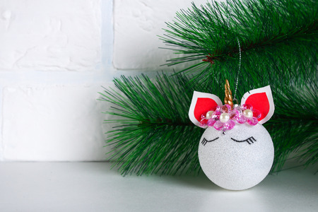 Diy, the unicorn. How to make a unicorn from a Christmas ball toy. Step by step guide photo. Christmas tree decorations