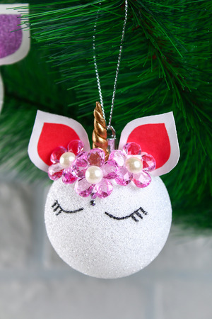 Diy, the unicorn. How to make a unicorn from a Christmas ball toy. Step by step guide photo. Christmas tree decorations. Stock Photo