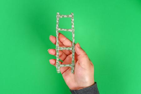 DIY ladder straws cocktail and washi tape St Patricks Day green background. Gift Idea, decor for leprechaun trap Saint Patricks Day. Step by step. Child kid craft process. Top view. Irish holiday.