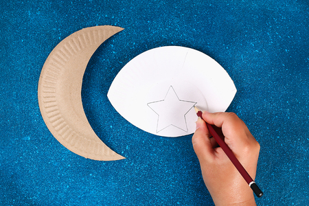 4 Diy Ramadan kareem crescent moon with a star from a disposable cardboard plate and gold paint. Gift idea, decor Ramadan kareem. Step by step. Top view. Process kid children craft. Workshop. Reklamní fotografie - 121519455