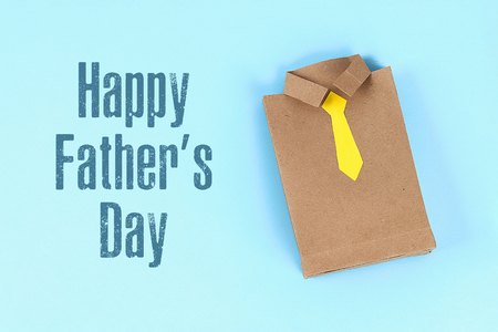 Diy fathers day gift bag package shirt with necktie crafting paper on a blue Reklamní fotografie - 122316738