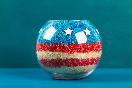 Diy 4th of July vase of glass jars and colored rice American flag, red, blue, white. Gift idea, decor July 4, USA Independence Day. Step by step. Top view. Process kid children craft. Workshop.