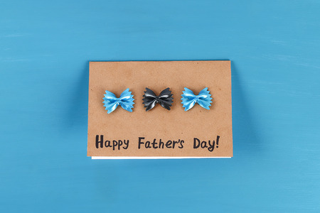 8 Diy greeting card father's dad day from pasta form bow tie blue background. Gift idea, decor Father day, Daddy. Step by step. Top view. Process kid children craft. Workshop. Happy Fathers day.