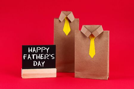 Craft packages gifts for fathers day in the form of a shirt and tie. A gift for fathers day.