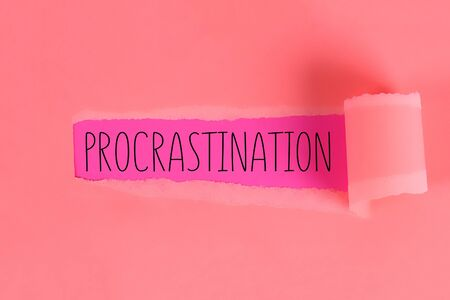 Procrastination, delay and urgency concept. Torn off piece of paper opening inscription procrastination.