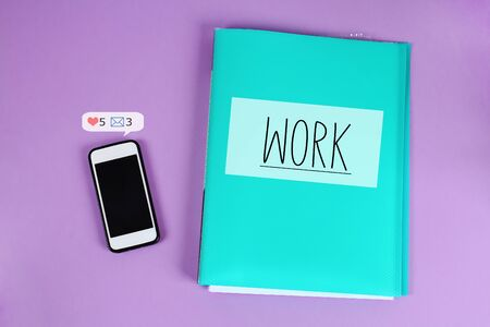 Procrastination, delay and urgency concept. The phone distracts from the work of social network alerts.