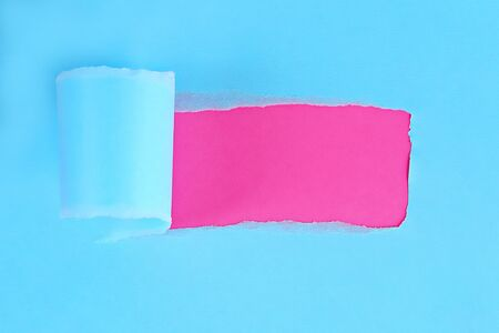 Torn color wrapped paper with space for your message. Hole ripped in paper on background. Copy space