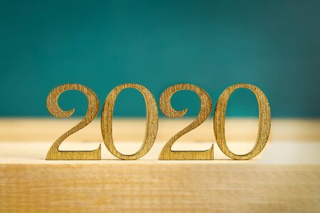 Happy New Year 2020. Creative text Happy New Year 2020 written in gold wooden letters. Merry christmas. Xmas. Imagens