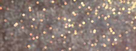 Blurred Bokeh. Holiday glowing backdrop. Christmas light background. Defocused Background With Blinking Stars. Stock Photo - 128518613