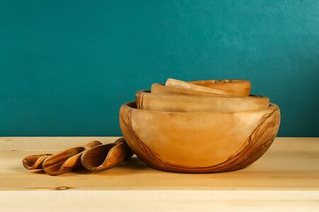 Wooden utensils. Wooden plates, cups, bowls. Dishes on the shelf Kitchenware