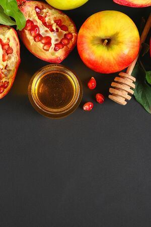 Rosh hashanah jewish New Year holiday concept. Traditional symbol. Apples, honey, pomegranate. Copy space. Top view. Flat lay