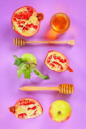 Rosh hashanah jewish New Year holiday concept. Traditional symbol. Apples, honey, pomegranate. Top view. Flat lay