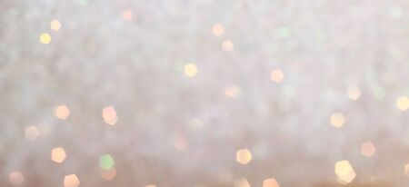 Blurred Bokeh. Holiday glowing backdrop. Christmas light background. Defocused Background With Blinking Stars. Banco de Imagens