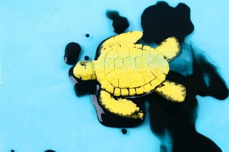 Turtle in oil. pollution in ocean environmental problem. Ecological situation in the world earth. Pollution of nature. Zero waste. ocean pollution concept