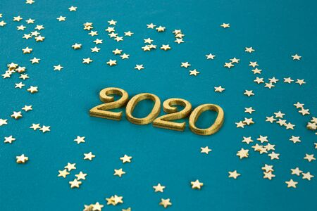Happy New Year 2020. Creative text Happy New Year 2020 written in gold wooden letters. Merry christmas. Xmas. Banco de Imagens