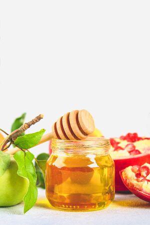 Rosh hashanah jewish New Year holiday concept. Traditional symbol. Apples, honey, pomegranate
