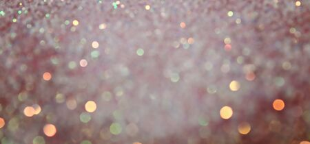 Blurred Bokeh. Holiday glowing backdrop. Christmas light background. Defocused Background With Blinking Stars. Stock Photo