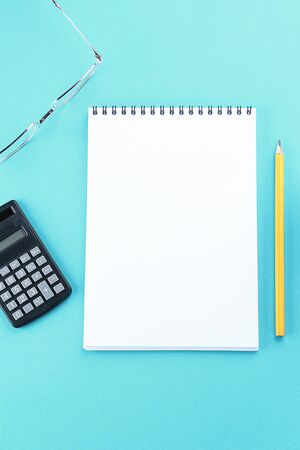 Top view image of open notebook with blank pages on blue background, ready for adding or mock up. Still life, business, office supplies or education concept Stok Fotoğraf