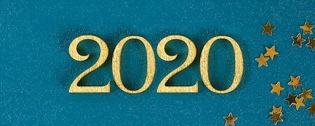 Happy New Year 2020. Creative text Happy New Year 2020 written in gold wooden letters. Merry christmas. Xmas. Banner.