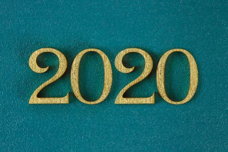 Happy New Year 2020. Creative text Happy New Year 2020 written in gold wooden letters. Merry christmas. Xmas. Zdjęcie Seryjne