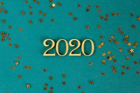 Happy New Year 2020. Creative text Happy New Year 2020 written in gold wooden letters. Merry christmas. Xmas. Stock Photo