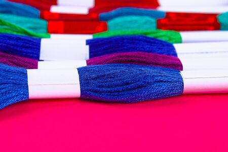 Multicolored thread for embroidery. Colorful thread for embroidery.