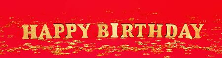 Text Happy birthday laid out of gold letters on a beautiful background. Golden stars confetti. Banner Zdjęcie Seryjne