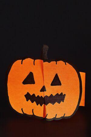 Diy Halloween paper bracelet pumpkin on black background. Gift idea, decor Halloween. Step by step. Top view. Process kid children Halloween craft. Workshop.