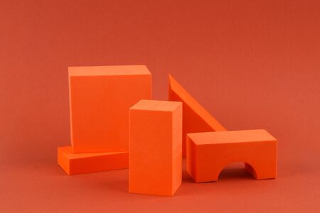 Orange geometric shapes on a brown background. Template composition for advertising, products.