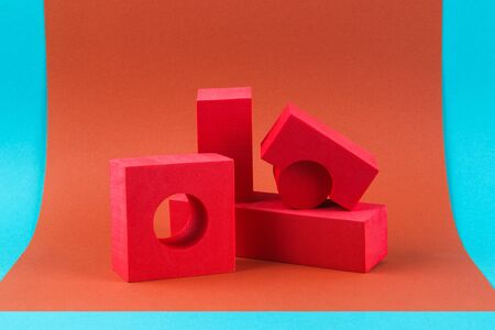 Red geometric shapes on a brown background. Template composition for advertising, products.