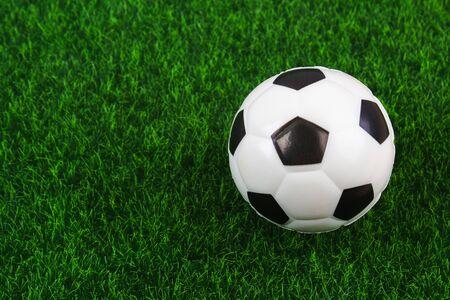 Traditional soccer ball on soccer field. Football ball on a green grass stadium football field, game, sport. Background for design.