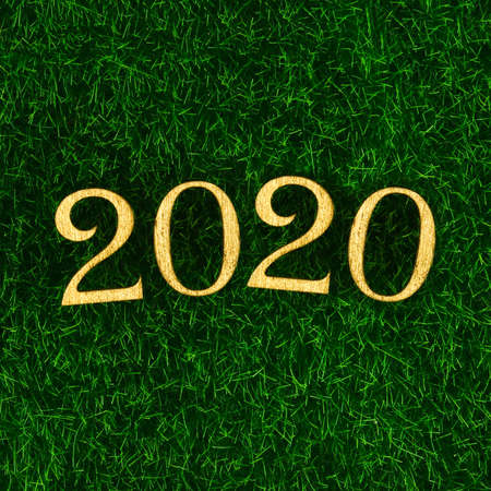 Happy New Year 2020. Creative text Happy New Year 2020 written in gold wooden letters. Merry christmas. Xmas. Archivio Fotografico