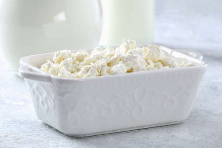 Cottage cheese with berries and mint. Cottage cheese in a bowl. Dairy products. Stock fotó