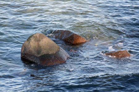 baltic sea waves crashing to shore along coastline