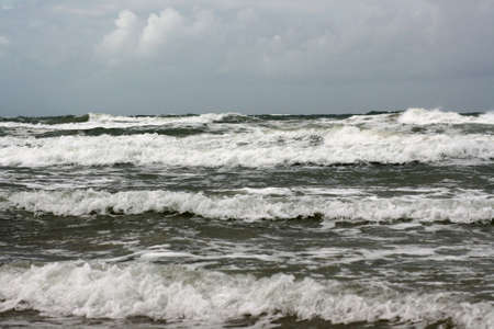 rough sea: north sea waves crashing to shore along coastline Stock Photo